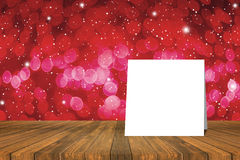 White card put on table and blurred bokeh out of focus in christmas night light background. product display template Royalty Free Stock Photo