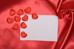 White card  on red silk Stock Image