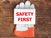 White card in  safety glove on wooden Stock Photos