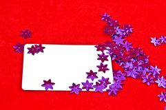 White card and violet stars Stock Image