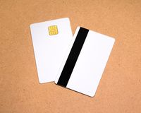 White card on wooden background. Template of blank credit card for your design. Card royalty free stock photography
