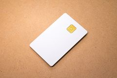 White card on wooden background. Template of blank credit card for your design. White card on wooden background. Template of blank credit card stock images
