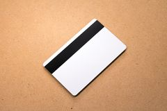 White card on wooden background. Template of blank credit card for your design. White card on wooden background. Template of blank credit card royalty free stock photos