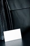 White card for writing with black leather bag on the table Royalty Free Stock Images
