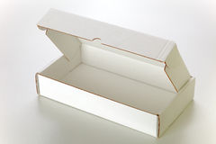 White cardboard box. A open white cardboard box isolated on grey background Royalty Free Stock Photography