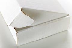 White cardboard box. A open white cardboard box  on grey background Royalty Free Stock Photos