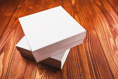 White cardboard boxes. Two white cardboard boxes standing on the wooden table Stock Photography