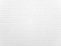 White cardboard sheet. Off white cardboard sheet with horizontal stripes stock image