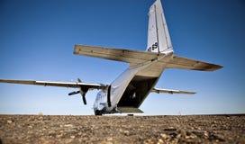 White Cargo Plane. White twin prop cargo plane sits on a runway royalty free stock photos