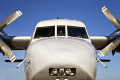 White Cargo Plane. White and blue, twin propeller cargo aircraft Royalty Free Stock Photography