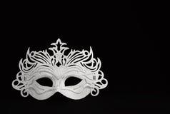 White carnival mask on a black background 1 Stock Image