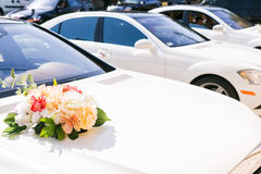 White cars decorated with flowers composition on wedding Stock Photos