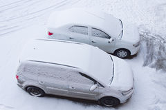 White cars in the parking lot in the morning after a snowfall Stock Images