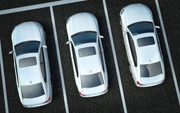 White cars on a parking place Stock Photo