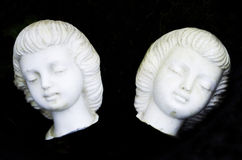 White carved faces Royalty Free Stock Photos