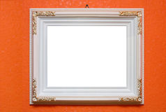 White carved frame. Dangling on a wall Stock Photo