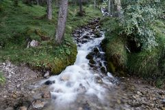 White cascades in a brook appearing rapid and soft Stock Photo