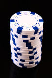 White casino chips on black Royalty Free Stock Photography