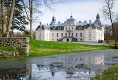 White castle. Beautiful castle in spring light Stock Photos