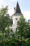 White Castle in the Art Nouveau. Among the trees in the summer Royalty Free Stock Photography