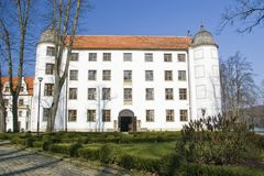 White castle facade. A white castle facade, a lawn in front of it. Situated in Krag, Poland Stock Photos