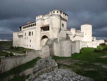 White castle, stormy clouds, Cuellar, Spain Royalty Free Stock Image