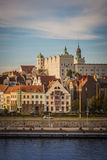 White castle with towers and green roofs and red roofs of residential and office houses and river in Szczecin, Poland Stock Photos