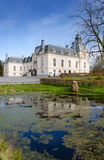 White castle with water reflection. White Swedish castle in vertical landscape Stock Image