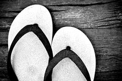 White casual slippers on wood background Stock Image