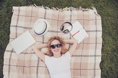 White casual t-shirt read copybook listen music bluetooth earpho. Nes spring open-air peace pleasure people person lifestyle leisure concept. Cute lovely lady Stock Photos
