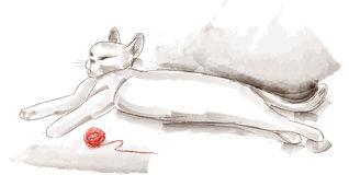 White cat with a ball of yarn Stock Image