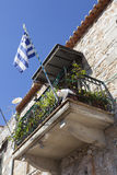 White cat and greek flag on balcony on old house in Greek town o Stock Image