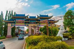 White cat monument is the Kuching South City Council Cat Statue. Sarawak Malaysia. His monument is a landmark for Kuching city and popular photo spot with Royalty Free Stock Photo