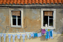 White Cat Window Clothesline. White cat sitting in a window overlooking a clothesline in Dubrovnik, Croatia Royalty Free Stock Image