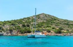 White catamaran on azure water against blue sky Stock Photography