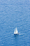 White catamaran on blue water. A catamaran on a blue sea water Royalty Free Stock Photography