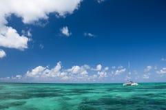 White catamaran with tourists. White catamar with tourists on  turquoise ocean near Cayo Blanco, Cuba Stock Photo