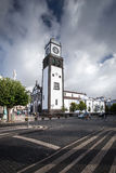 White cathedral clock tower - Azores Portugal Sao Miguel Ponta D stock images
