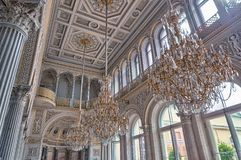 White Cathedral Hanging With Three Brown Uplight Chandelier Royalty Free Stock Image