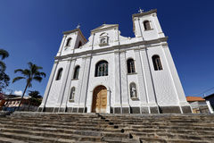 White catholic church under intense blue cloudless sky Royalty Free Stock Photos