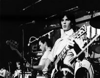 The White Cats. Steve Turner (left) and Eddie Cox of British pop group The White Cats, perform live on stage in London, circa 1978. The group was led by drummer Royalty Free Stock Photo