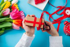 White caucasian female hands wrapping gift near things for decor Royalty Free Stock Image