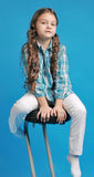 White caucasian girl  on a bar stool Stock Images