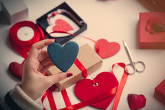 White caucasian hand holding heart shaped toy on the wonderful t stock photography
