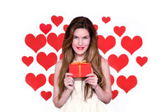 White caucasian woman with red lips holding a gift heart shaped background.Valentine day concept Royalty Free Stock Photos