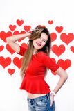 White caucasian woman with red lips standing and playing with hair on heart shaped background.Valentine`s Royalty Free Stock Images