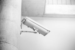 White CCTV camera in the school or university campus building. White CCTV camera in the school or university campus building, white clean trust security concept royalty free stock photos