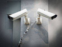 White CCTV (Closed circuit TV) camera security monitoring on cement wall Royalty Free Stock Image