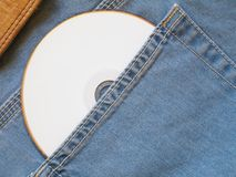 White CD. White compact disc within blue jeans pocket stock images