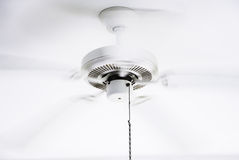 White ceiling electrical fan in motion Stock Images